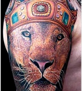 Adorable lion king style tattoo on arm
