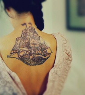 Adorable women's back ship tattoo