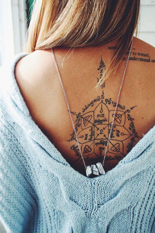 Amazing black back tattoo