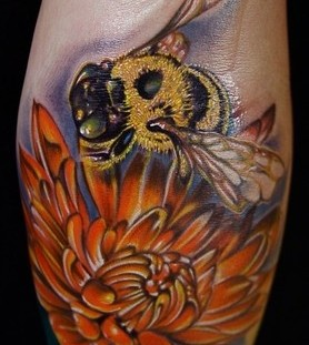 Amazing flower and bee tattoo on arm