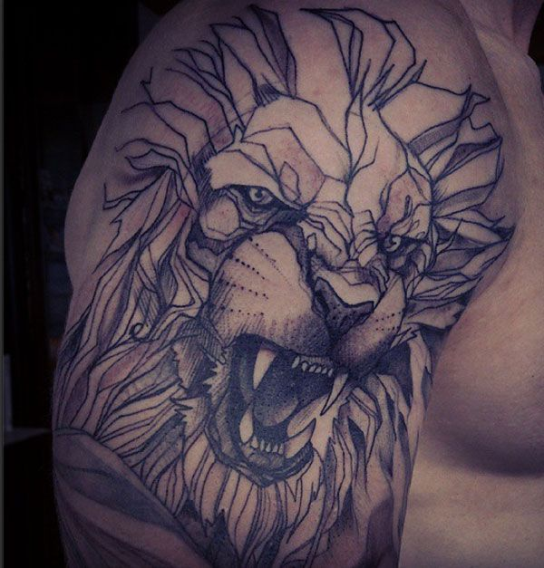 Angry looking lion tattoo