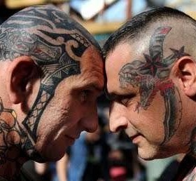 Angry two men's and tattoo on head