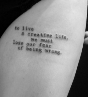 Awesome black quote tattoo