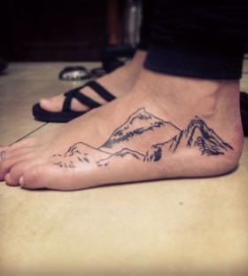 Awesome foot mountain tattoo