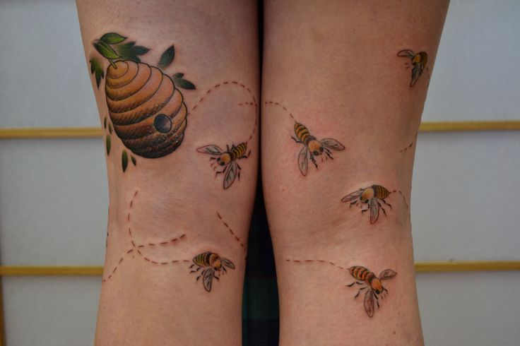 Awesome looking bee tattoo on leg