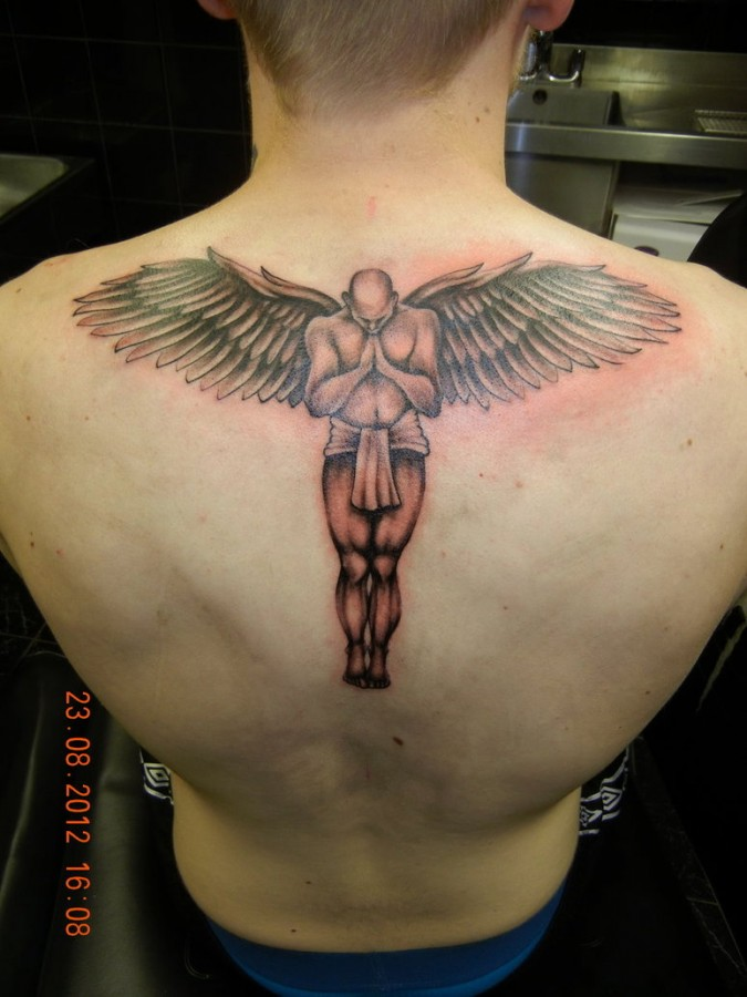 Awesome men's back angel tattoo
