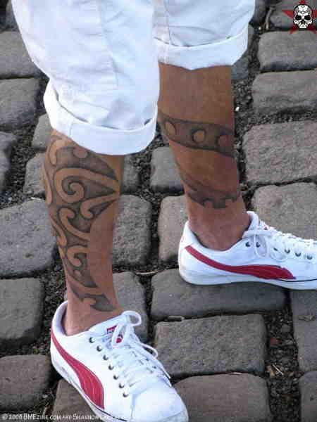 Awesome trainers and tattoo on men's legs