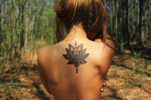 Back women's snail tattoo