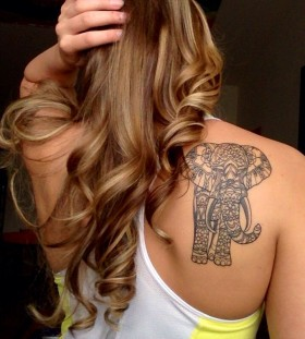Beautiful girl's hair and black shoulder elephant tattoo