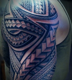Best tribal blue men's tattoo