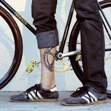 Bike black tattoo on men's legs