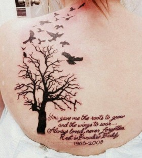 Birds and girl's black tree tattoo