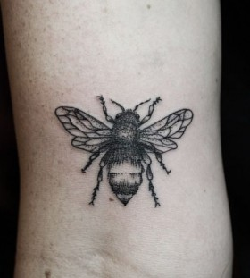 Black adorable bee tattoo on arm
