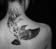 Black adorable bird tree tattoo