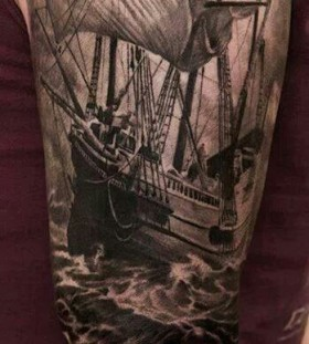 Black adorable ship tattoo