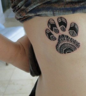 Black and white dog tattoo