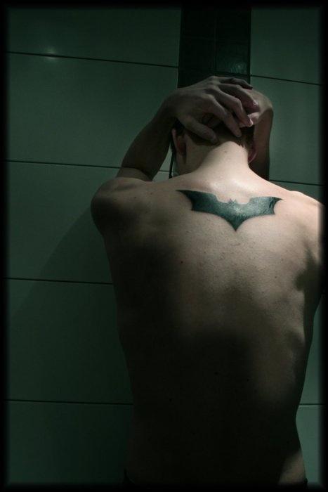 Black back batman tattoo