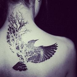Black bird back tattoo
