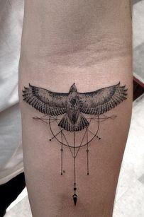 Black bird compass tattoo