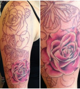 Black butterfly and pink rose tattoo