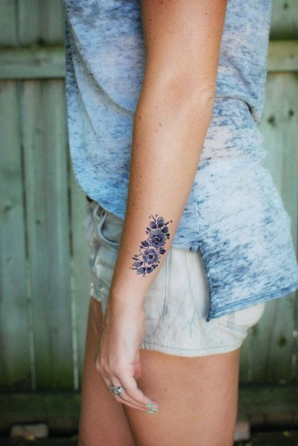 Black cool flowers placement tattoo
