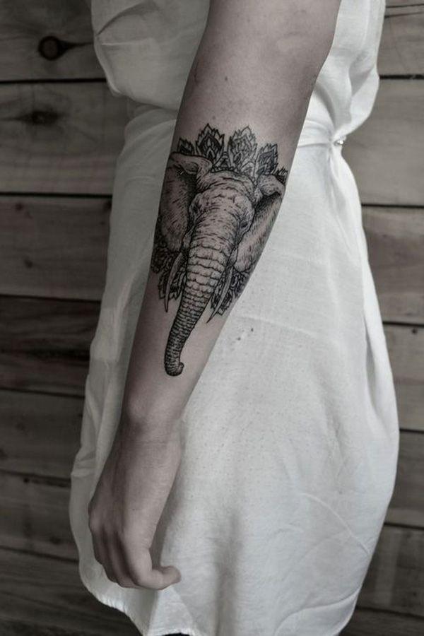 Black cool looking elephant tattoo