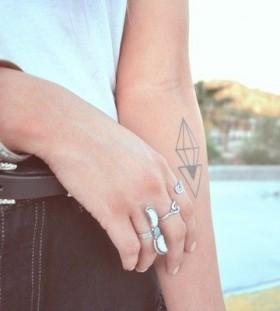 Black crystal geometric style tattoo