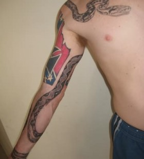 Black dragon and snake tattoo on arm and shoulder