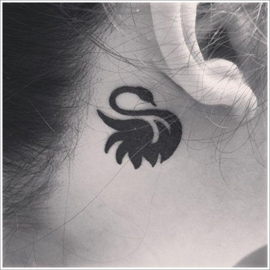 Black ear swan tattoo