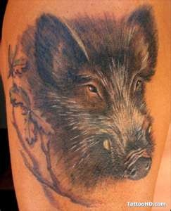 Black face pig tattoo