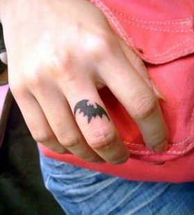 Black finger batman tattoo