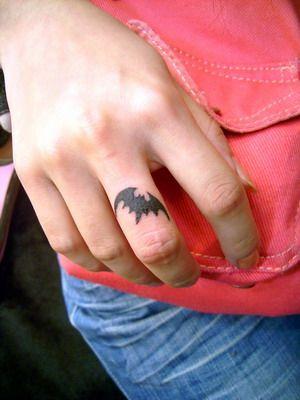 Black finger batman tattoo