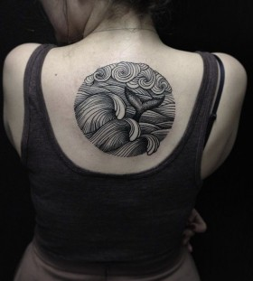 Black fish back tattoo