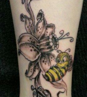 Black flower and yellow bee tattoo on leg