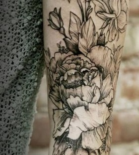 Black flowers and bee tattoo on arm