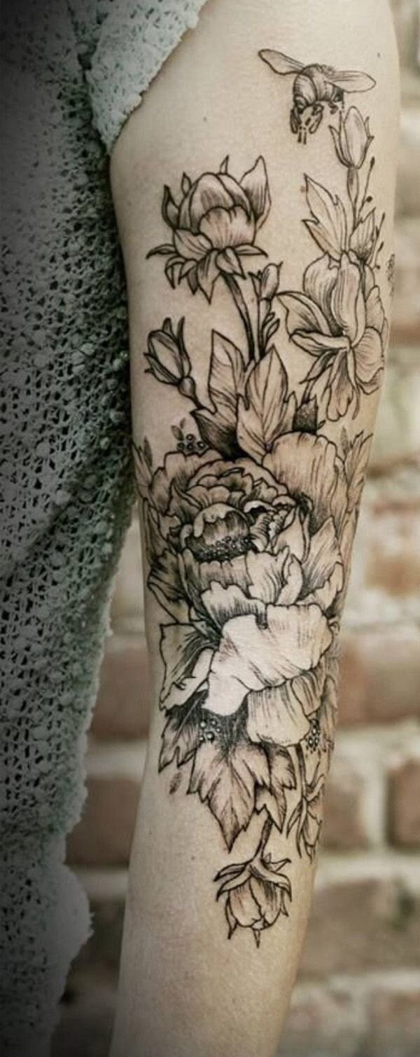 2d83ff9c7b072 Black flowers and bee tattoo on arm - | TattooMagz › Tattoo Designs / Ink  Works / Body Arts Gallery