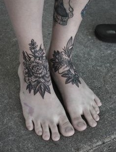 Black flowers foot tattoo