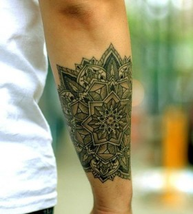 Black flowers men's arm tattoo