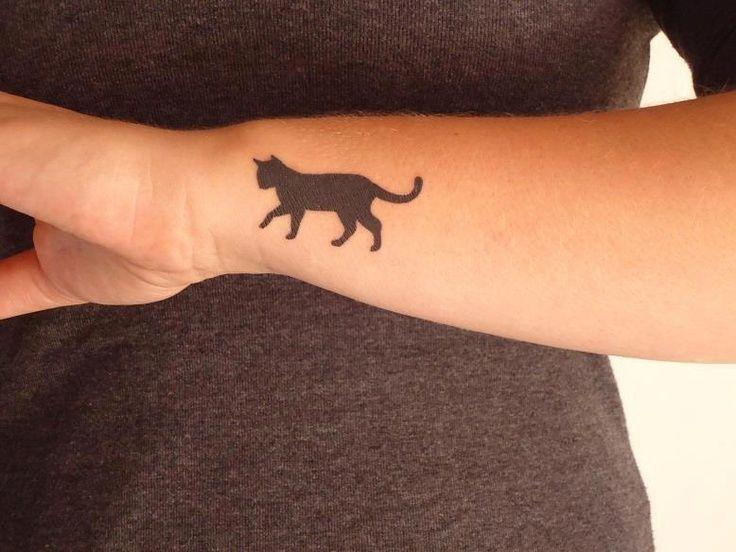 Black gorgeous cat tattoo