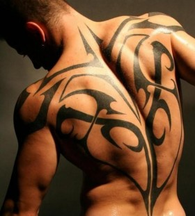 Black gorgeous ornamentally men's back tattoo