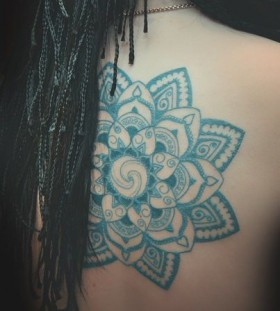 Black hair blue tattoo