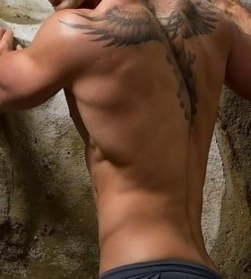 Black hair men's back tattoo