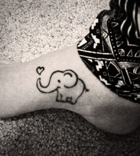 Black heart and lovely elephant tattoo