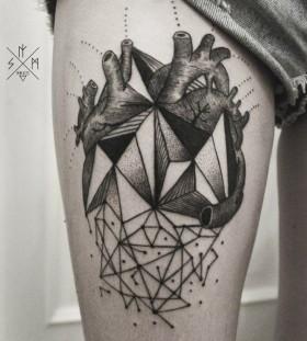 Black heart geometric style tattoo