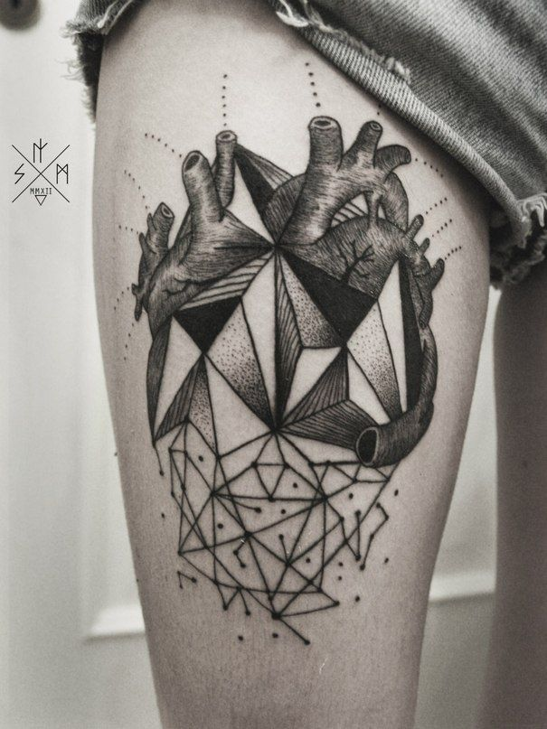 Black heart geometric style tattoo