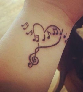 Black heart music style tattoo