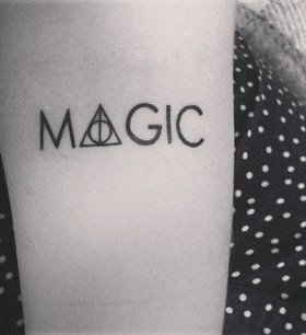 Black insanely magic tattoo