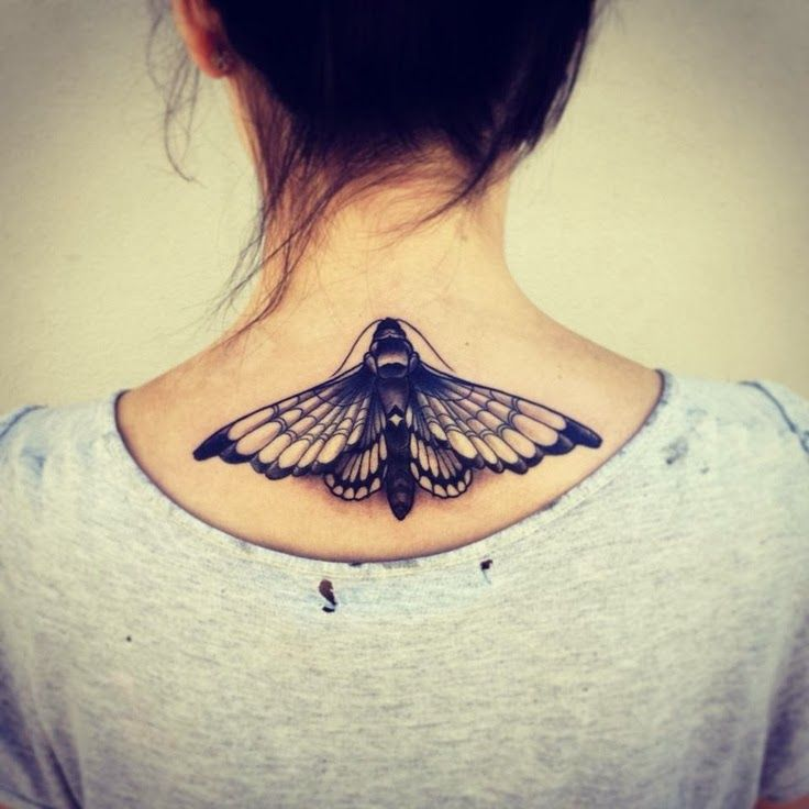 Black insect back tattoo