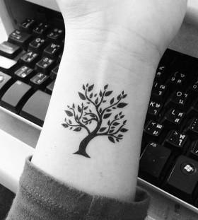 Black leafs tree tattoo