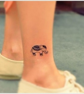 Black leg elephant tattoo